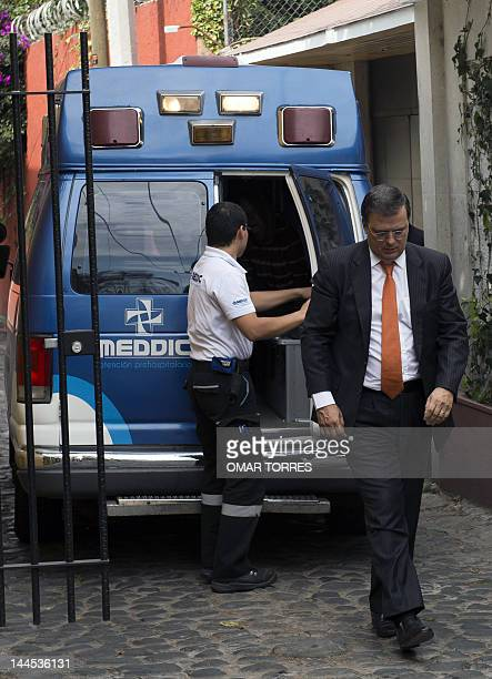 Mexico City's Mayor Marcelo Ebrard leaves the ambulance carrying the remains of Mexican writer Carlos Fuentes, in front of the latter's home on May...