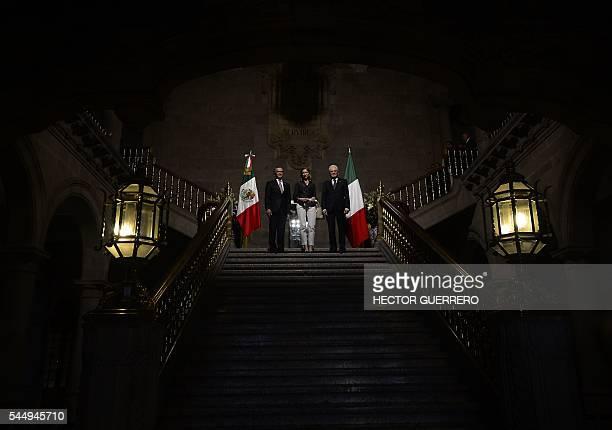 Mexico City's Mayor Miguel Angel Mancera Italian first lady Laura Mattarella and Italian President Sergio Mattarella pose for the photographers in...