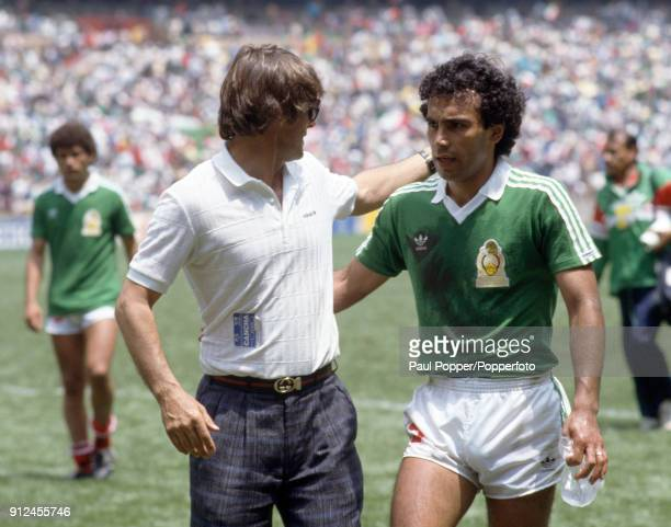 Mexico coach Bora Milutinovic with Hugo Sanchez following their victory in the FIFA World Cup match between Belgium and Mexico at the Estadio Azteca...