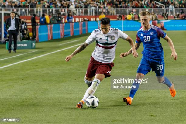Mexico Defender Carlos Salcedo defends against Iceland Forward Albert Gudmundsson during the first half of the international match between Mexico and...