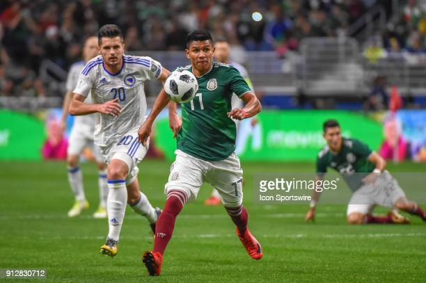 Mexico defender Jesus Gallardo and Bosnia and Herzegovina midfielder Goran Zakaric chase a loose ball during first half action during the soccer...