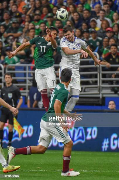 Mexico defender Jesus Gallardo and Bosnia and Herzegovina midfielder Tomislav Tomic fight for a header during second half action during the soccer...