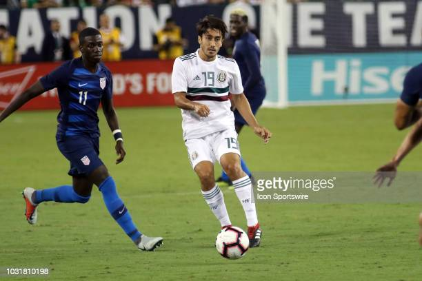 Mexico defender Jose Abella moves past United States defender Shaq Moore in the game between the United States National team and the Mexico National...