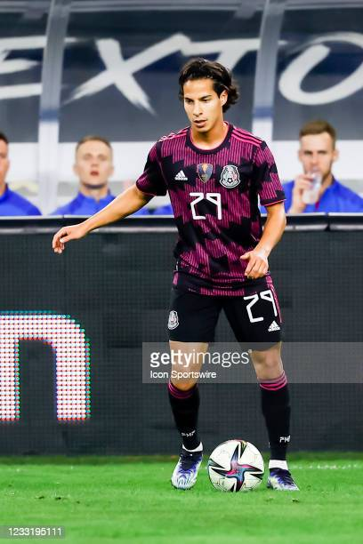 Mexico Diego Lainez dribbles the ball during the game between Mexico and Iceland on May 29, 2021 at AT&T Stadium in Arlington, Texas.