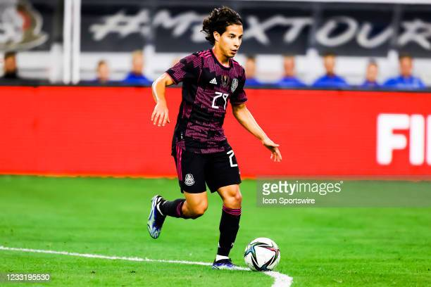 Mexico Diego Lainez dribbles the ball upfield during the game between Mexico and Iceland on May 29, 2021 at AT&T Stadium in Arlington, Texas.