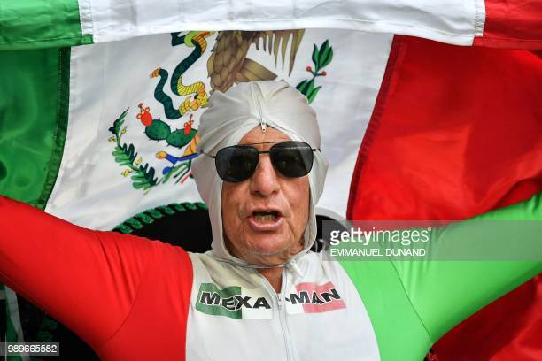 Mexico fan cheers before the Russia 2018 World Cup round of 16 football match between Brazil and Mexico at the Samara Arena in Samara on July 2,...