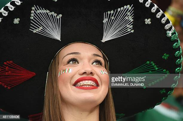 A Mexico fan cheers prior to a Group A football match between Croatia and Mexico at the Pernambuco Arena in Recife during the 2014 FIFA World Cup on...