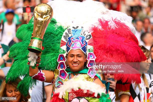 Mexico fan holds a replica World Cup trophy prior to the 2018 FIFA World Cup Russia group F match between Germany and Mexico at Luzhniki Stadium on...