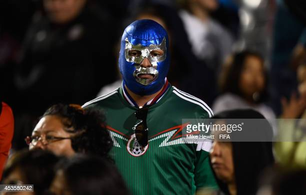 Mexico fan is distraught after Mexico lost in the FIFA U20 Women's World Cup Canada 2014 Group D match between Korea Republic and Mexico at the...