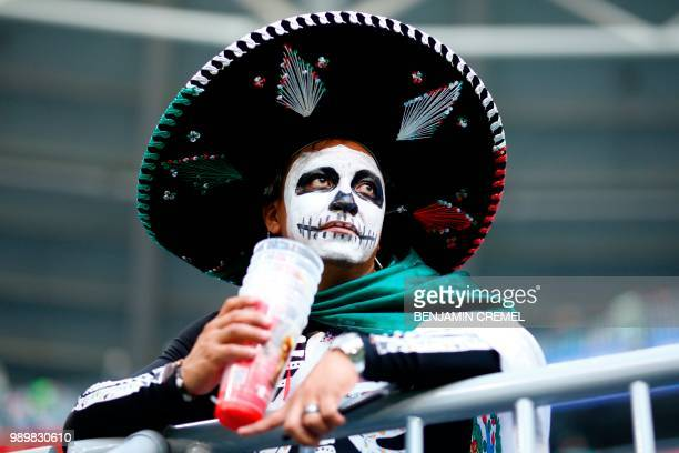 Mexico fan looks on after the Russia 2018 World Cup round of 16 football match between Brazil and Mexico at the Samara Arena in Samara on July 2,...