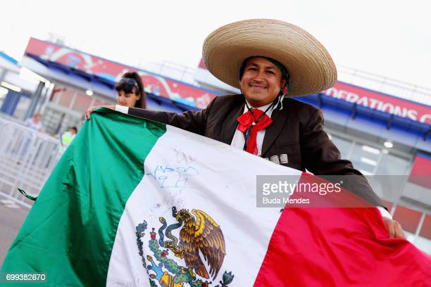 Mexico fan poses with a Mexico flag outside the stadium prior to the FIFA Confederations Cup Russia 2017 Group A match between Mexico and New Zealand...