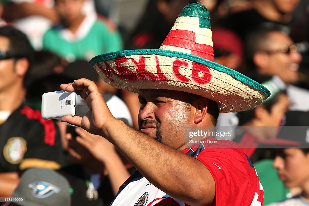 A Mexico fan takes a photo during the game against Panama during the first round of the 2013 CONCACAF Gold Cup at the Rose Bowl on July 7, 2013 in Pasadena, California. Panama won 2-1.