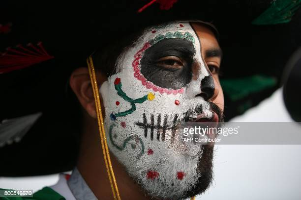 A Mexico fan waits for the start of the 2017 Confederations Cup group A football match between Mexico and Russia at the Kazan Arena Stadium in Kazan...