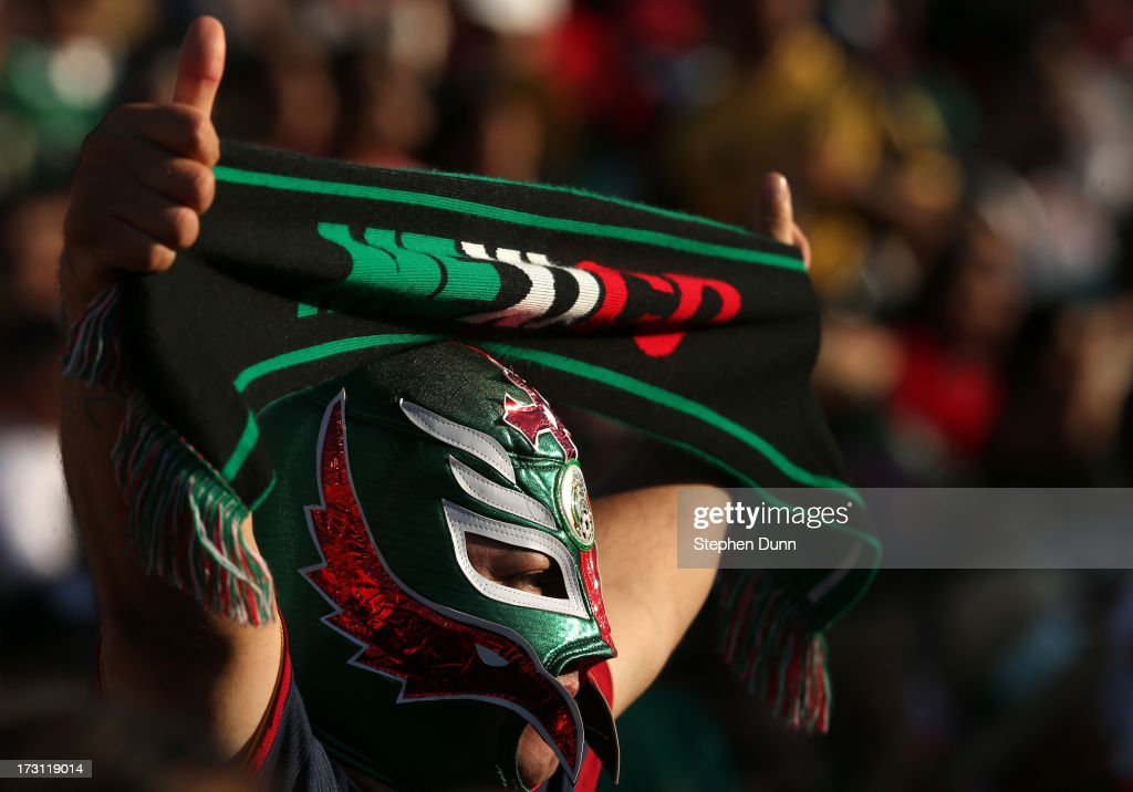 A Mexico fan wearing a luche libre mask holds up a scarf in the game with Panama during the first round of the 2013 CONCACAF Gold Cup at the Rose Bowl on July 7, 2013 in Pasadena, California. Panama won 2-1.
