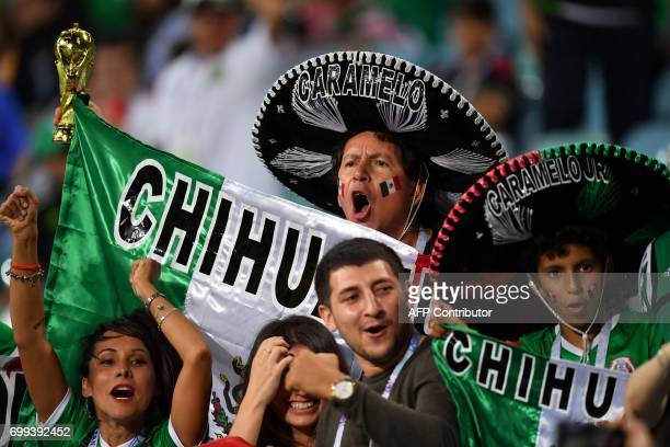 A Mexico fan wearing a sombrero cheers ahead of the 2017 Confederations Cup group A football match between Mexico and New Zealand at the Fisht...
