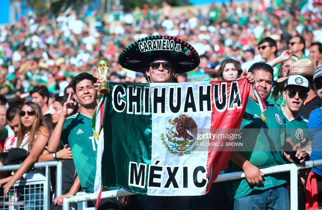Mexico fans, among the over 80,000 in attendance, cheer their team against Wales during their international soccer friendly at the Rose Bowl in Pasadena, California on May 28, 2018. - The game ended 0-0.