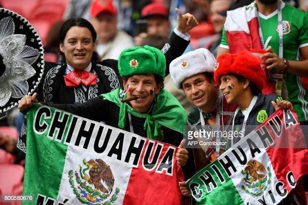 Mexico fans attend the 2017 Confederations Cup group A football match between Mexico and Russia at the Kazan Arena Stadium in Kazan on June 24 2017 /...