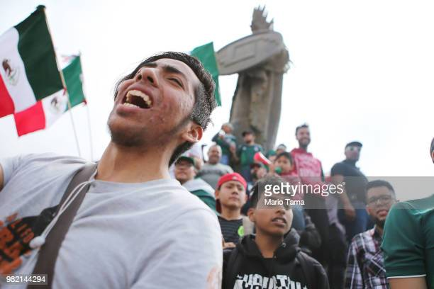 Mexico fans celebrate at the Cuauhtemoc monument after their 21 victory over South Korea during the World Cup on June 23 2018 in Tijuana Mexico