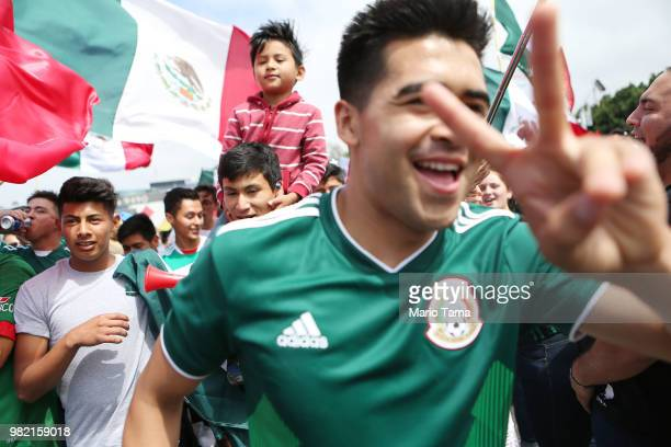 Mexico fans celebrate at the Cuauhtemoc monument after their 21 victory over South Korea during the World Cup on June 23 2018 in Tijuana Mexico In...