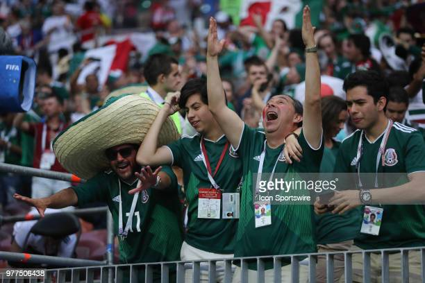 Mexico fans celebrate their team scoring a goal during a Group F 2018 FIFA World Cup soccer match between Germany and Mexico on June 17 at the Kazan...