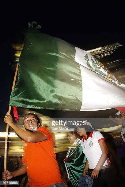 Mexico fans celebrate their victory against El Salvador for the FIFA 2010 World Cup Qualifier 2009 at the Angel of Independence's square on October...