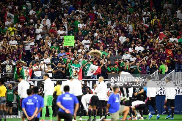 Mexico fans cheer as the players enter the field ahead of the Concacaf Gold Cup football match semifinal between Mexico and Canada at NRG stadium in...