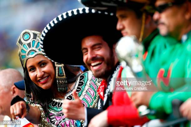 Mexico fans cheer before the Russia 2018 World Cup round of 16 football match between Brazil and Mexico at the Samara Arena in Samara on July 2,...