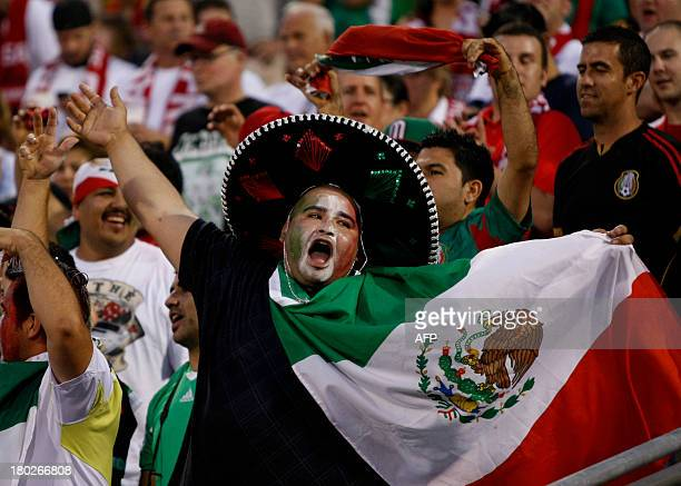 Mexico fans cheer before the start of the Brazil 2014 FIFA World Cup qualifier against USA at Columbus Crew Stadium in Columbus Ohio September 10...