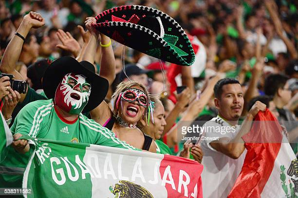 Mexico fans cheer during the 2016 Copa America Centenario Group C match between Mexico and Uruguay at University of Phoenix Stadium on June 5 2016 in...