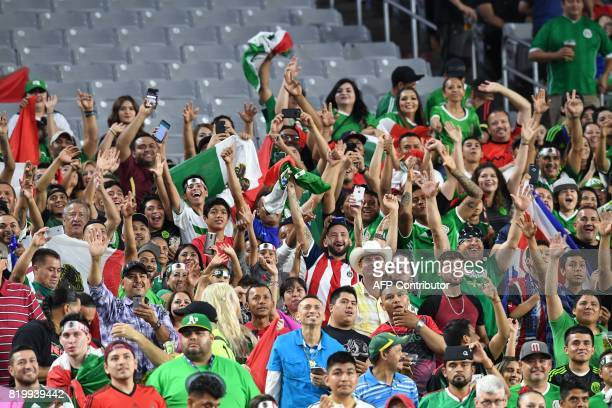Mexico fans cheer during their 2017 CONCACAF Gold Cup quarterfinal match against Honduras at the University of Phoenix Stadium on July 20 2017 in...