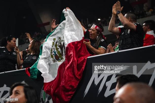 Mexico fans cheer following a goal during the international friendly match between Venezuela and Mexico at MercedesBenz Stadium in Atlanta Georgia on...