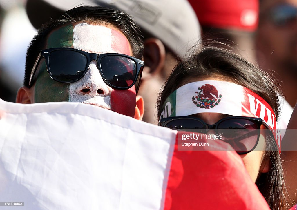 Mexico fans hold up a flag during the game with Panama during the first round of the 2013 CONCACAF Gold Cup at the Rose Bowl on July 7, 2013 in Pasadena, California.