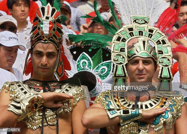 Mexico fans in Aztec costume salute during ther national anthem, 17 June 2002 at the Jeonju World Cup Stadium in Jeonju, ahead of second round...