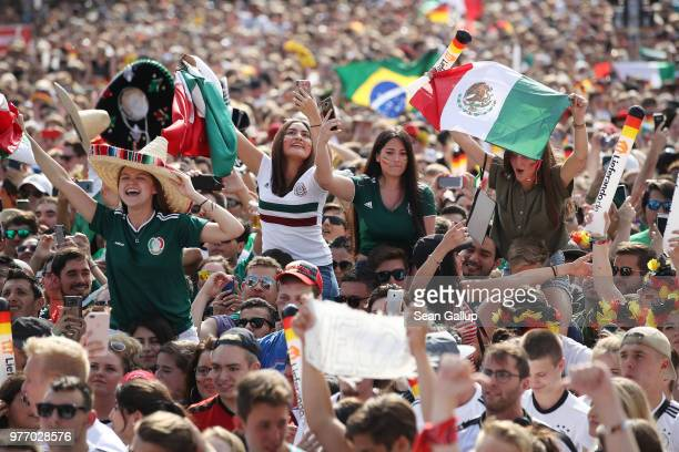 Mexico fans join crowds at the Fanmeile public viewing area prior to the Germany vs Mexico 2018 FIFA World Cup match on June 17 2018 in Berlin...