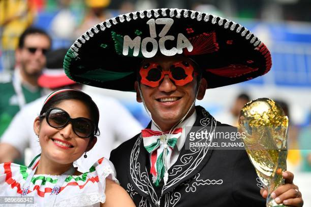 Mexico fans pose before the Russia 2018 World Cup round of 16 football match between Brazil and Mexico at the Samara Arena in Samara on July 2, 2018....