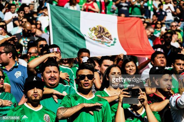 Mexico fans sing their national anthem during the Mexico vs Paraguay friendly soccer match on July 1 2017 at CenturyLink Field in Seattle Washington
