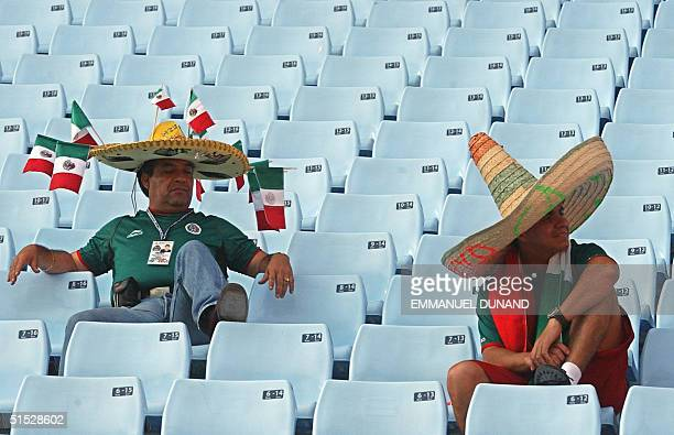 Mexico fans sit in disappointment 17 June 2002 at the Jeonju World Cup Stadium in Jeonju following second round playoff action between Mexico and USA...