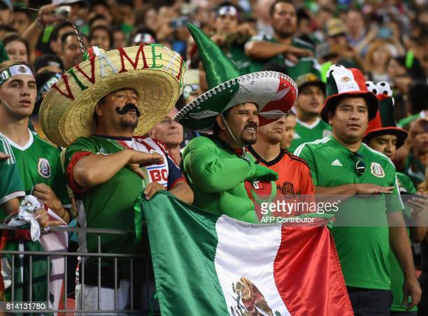 Mexico fans stand at attention before their Group C game against Jamaica in their CONCACAF Group C Gold Cup soccer game on July 13 2017 at Sports...