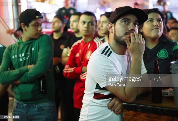 Mexico fans watch a live broadcast in a sports bar during Mexico's 2-0 loss to Brazil during the World Cup on July 2, 2018 in Tijuana, Mexico. Mexico...