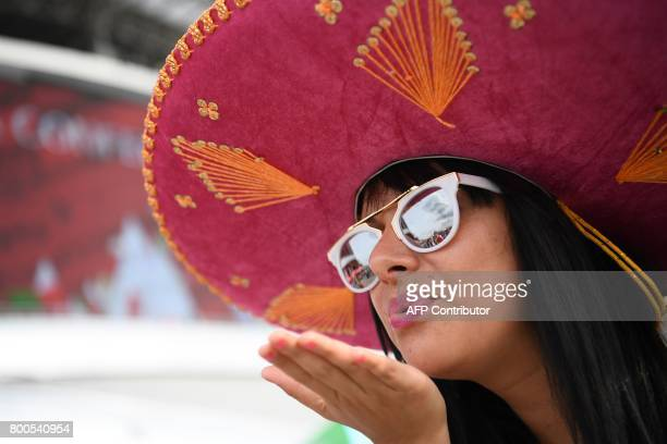 A Mexico football fan waits for the start of the 2017 Confederations Cup group A football match between Mexico and Russia at the Kazan Arena Stadium...