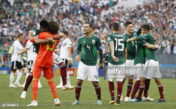 Mexico football players celebrate a 10 victory over Germany in a World Cup group stage match at the Luzhniki Stadium in Moscow Russia on June 17 2018...