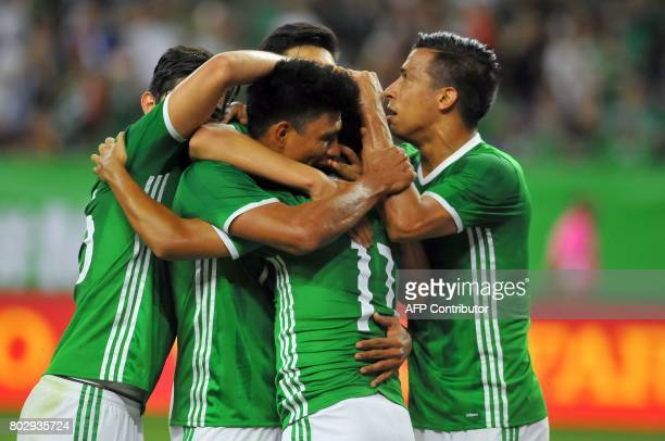 Mexico footballers celebrate their goal against Ghana during the friendly match between Mexico and Ghana at NRG stadium on June 28 2017 in Houston...