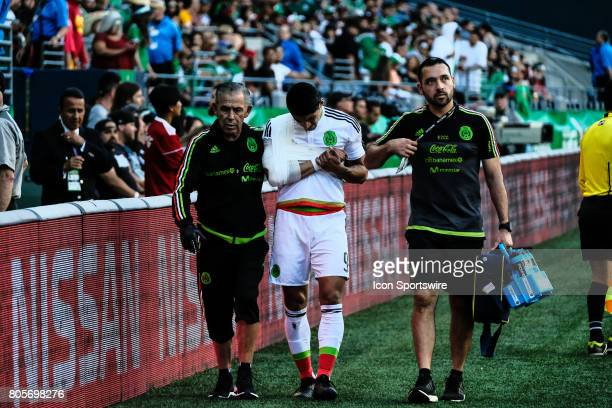 Mexico forward Alan Pulido leaves the game with a fractured arm during the Mexico vs Paraguay friendly soccer match on July 1 2017 at CenturyLink...