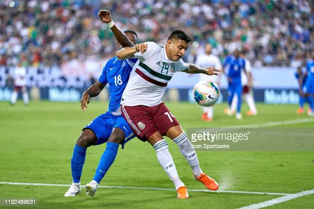 Mexico forward Alexis Vega battles with Martinique defender Samuel Camille in game action during a Gold Cup Group A match between Mexico and...