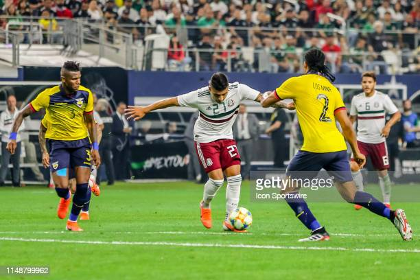 Mexico forward Alexis Vega dribbles the ball through Ecuador defenders during the game on June 09 2019 at ATT Stadium in Arlington Texas