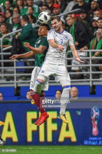Mexico forward Carlos Vela and Bosnia and Herzegovina midfielder Tomislav Tomic fight for a header during the soccer match between Mexico and Bosnia...