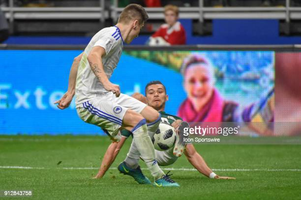 Mexico forward Elias Hernandez and Bosnia and Herzegovina defender Almir Bekic fight for a loose ball during the soccer match between Mexico and...