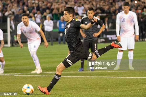 Mexico forward Raul Jiménez takes a penalty kick and scores during the International match between the Mexico National Team and Chile on March 22,...