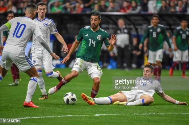 Mexico forward Rodolfo Pizarro attempts to take a shot as Bosnia and Herzegovina midfielder Dino Besirevic defends during second half action during...