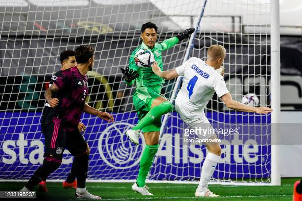 Mexico goalkeeper Alfredo Talavera leaps for the soccer ball over Iceland Hjortur Hermannsson during the game between Mexico and Iceland on May 29,...